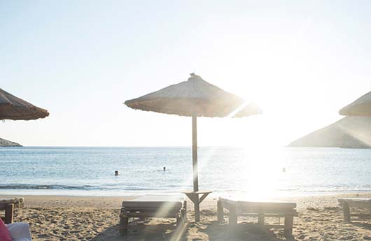Sunbathing at Mavros Molos Beach - Kissamos Property Guide by ARENCORES